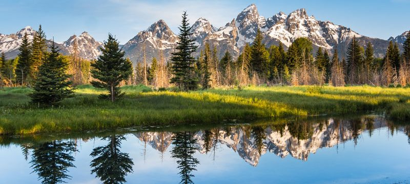 Wyoming Grand Teton National Park A Mountain Range with Its Reflection. Rocky Mountain