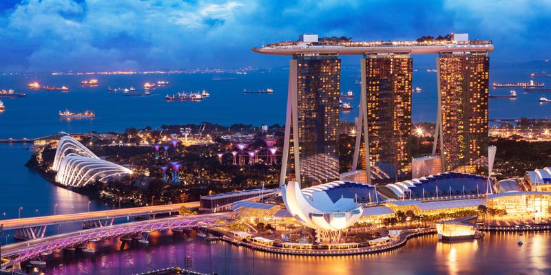Landscape of Singapore business building around Marina bay, in business district area at twilight